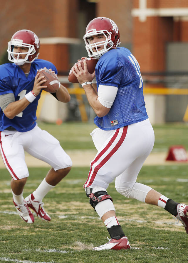 Kendal Thompson, left, and Blake Bell throw during spring practice on Tuesday. Bell, Thompson and Trevor Knight are battling for the vacant starting quarterback spot. Photo by Steve Sisney, The Oklahoman