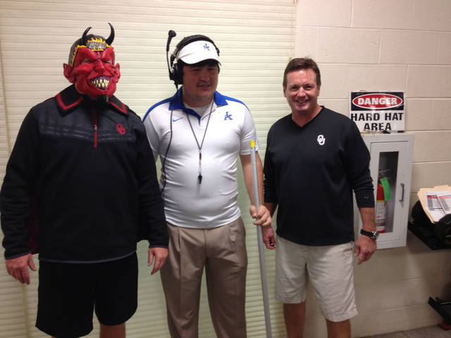 Defensive coordinator Mike Stoops as himself on the sideline any given Saturday (just kidding, coach), student trainer Sean Harris as Kentucky coach Mark Stoops and Bob Stoops as....himself.