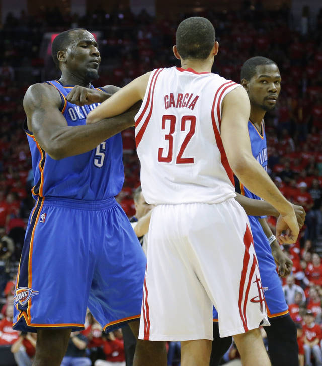Oklahoma City's Kendrick Perkins and Houston's Francisco Garcia get tangled up during Game 6 in the first round of the NBA playoffs between the Oklahoma City Thunder and the Houston Rockets at the Toyota Center in Houston, Texas, Friday, May 3, 2013. Photo by Bryan Terry, The Oklahoman