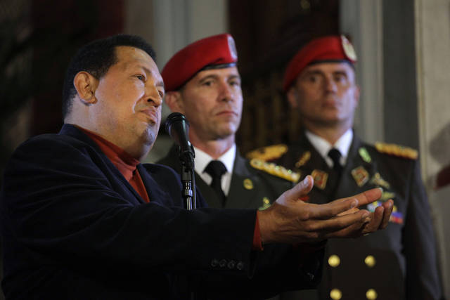 Venezuela's President Hugo Chavez talks during an impromptu news conference with the foreign press at Miraflores palace in Caracas, Venezuela, Saturday, Oct. 6, 2012. Chavez is running for re-election against opposition candidate Henrique Capriles in Sunday's presidential election. (AP Photo/Ramon Espinosa)