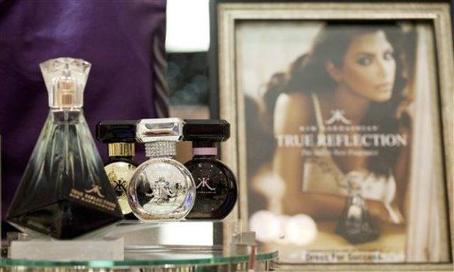 In this Aug. 23, 2012, photo, fragrances from the Kim Kardashian collection are displayed at a Lord & Taylor department store in New York. Celebrities have long dabbled in design, but with the growth of TV shows and websites that follow everything celebrities say, wear and do, interest in their clothing lines has risen in recent years. North America revenue from celebrity clothing lines, excluding merchandise linked to athletes, rose 6 percent last year to an historic peak of $7.58 billion in 2011, according to the latest figures available by The Licensing Letter, an industry trade. That�s on top of a nearly 5 percent increase in 2010. (AP Photo/Mark Lennihan)
