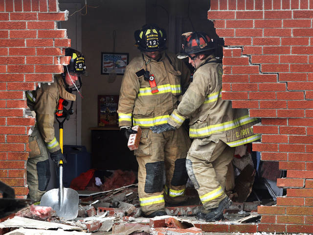 Oklahoma City firefighters look at damage to the north wall of the Skyview Nursing Center after a car drove through the brick exterior and into a resident's room on Thursday morning, Jan. 10, 2013. A firefighter at the scene said the car was occupied by a female driver when it plowed into the building at 2200 N. Coltrane. The room was unoccupied at the time of the accident and officials said there were no reported injuries.    Photo by Jim Beckel, The Oklahoman