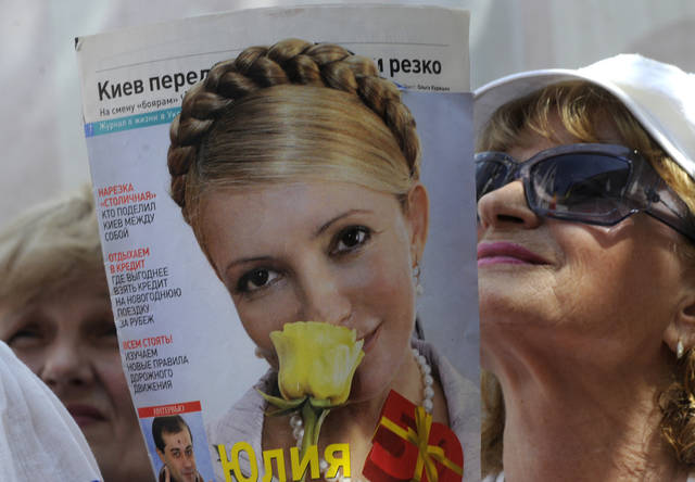 Supporters of former Ukrainian Prime Minister Yulia Tymoshenko take part in a rally in a tent camp in central Kiev, Ukraine, Wednesday, May 30, 2012. Tymoshenko, 51, is serving a seven-year term on charges of abuse of office, a case condemned as politically motivated by the West. Allegations she was beaten by prison officials in April have prompted top EU officials to announce a boycott of the football (soccer) championship games hosted in Ukraine during the June 8 - July 1 event. (AP Photo/Sergei Chuzavkov)