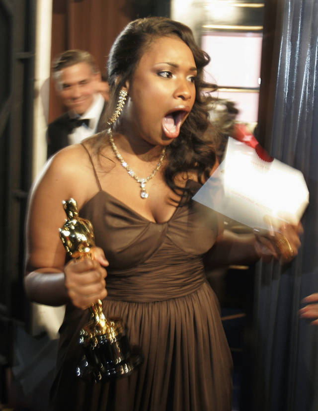 "FILE - In this Feb. 25, 2007 file photo, Jennifer Hudson reacts backstage after winning best supporting actress for her work in ""Dreamgirls"" during the 79th Academy Awards in Los Angeles. More accustomed to walking a red carpet in Vera Wang ballgowns, performing at the Grammy Awards or autographing her new book about weight-loss, the Oscar-winning actress and singer's next public appearance won't be glamorous. The starlet will be under a whole different spotlight in April 2012 in Chicago when she is expected to attend the triple murder trial of the man accused of killing her mother, brother and nephew. (AP Photo/Chris Carlson, File)"