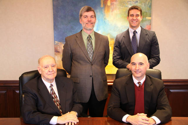 Four attorneys who specialize in intellectual property are joining the Hall Estill law firm. They are (back row) Dr. Michael S. Young, Tyler J. Mantooth and (front row) Bill D. McCarthy, Randy McCarthy. A fifth attorney who is joining the firm, Daniel Dooley, is not pictured. Photo PROVIDED