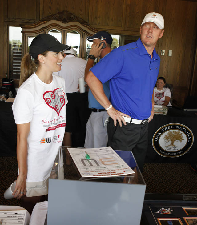 MELANIE WEEDEN: Brandon Weeden and wife Melanie look over some of his memorabilia after completing his charity golf tournament at Oak Tree National in Edmond, OK, Monday, July 23, 2012,  By Paul Hellstern, The Oklahoman
