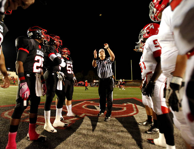 The referee throws the coin as the Carl Albert Titans play the Del City Eagles in Class 5A, first round, playoff action in high school football on Friday, Nov. 9, 2012 in Del City, Okla.   Photo by Steve Sisney, The Oklahoman