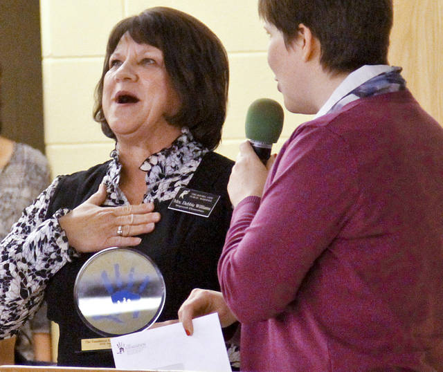 Media specialist Debbie Williams reacts after receiving an award during the Sequoyah Elementary School MAPS celebration on Monday, March 5, 2012 in Oklahoma City, Okla.  Photo by Chris Landsberger, The Oklahoman