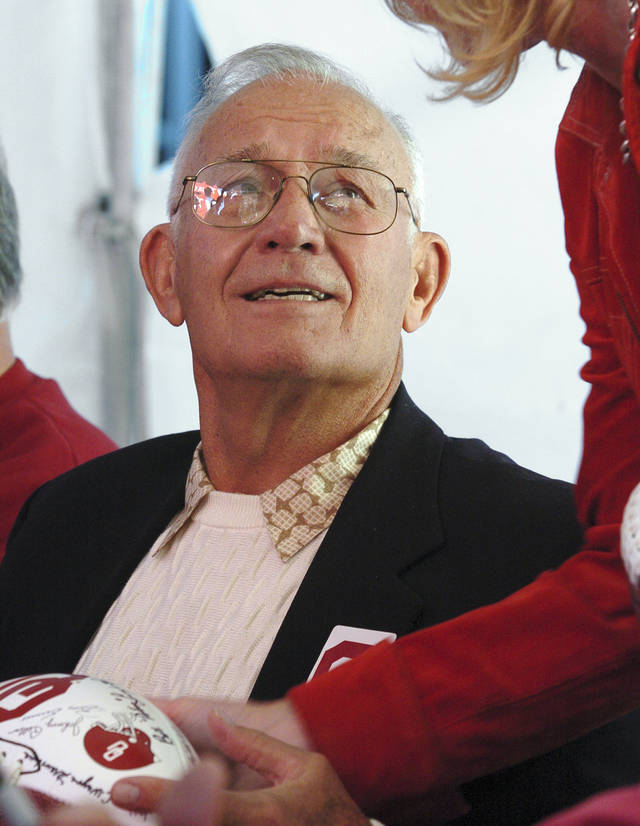 Bo Bolinger, members of the Sooner's 1955 National Championship football team,signs autographs at a tent outside the stadium before the Oklahoma Sooners (OU) college football game against Baylor (BU), at The Gaylord Family - Memorial Stadium, Saturday, October 22, 2005, in Norman, Oklahoma. by Steve Sisney/The Oklahoman.