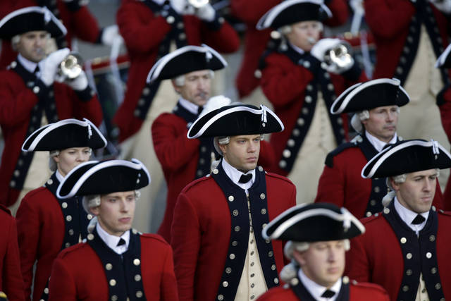 The Army's Old Guard Fife and Drum Corps walks down Pennsylvania Avenue en route to the White House, Monday, Jan. 21, 2013, in Washington. Thousands  marched during the 57th Presidential Inauguration parade after the ceremonial swearing-in of President Barack Obama. (AP Photo/Charlie Neibergall) ORG XMIT: DCMS123