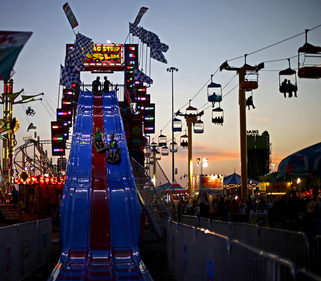 Children race down a slide after sunset in Oklahoma City, Wednesday, September 19, 2012. Photo by Bryan Terry, The Oklahoman