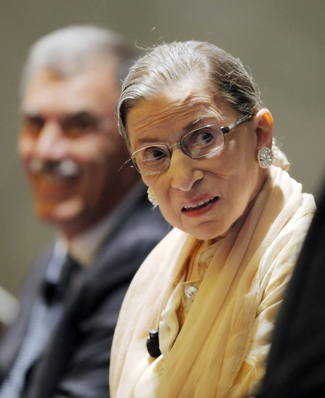 Supreme Court Justice and opera aficionado Ruth Bader Ginsburg participates in a panel discussion, Friday, Aug. 3, 2012, during the American Bar Association's annual meeting in Chicago. Ginsburg was joined other panelists as they listened to performances of arias in an unusual discussion of the lessons operatic performance can bring to the law. At left is U.S. Solicitor General Donald Verrilli, Jr. (AP Photo/Kiichiro Sato)