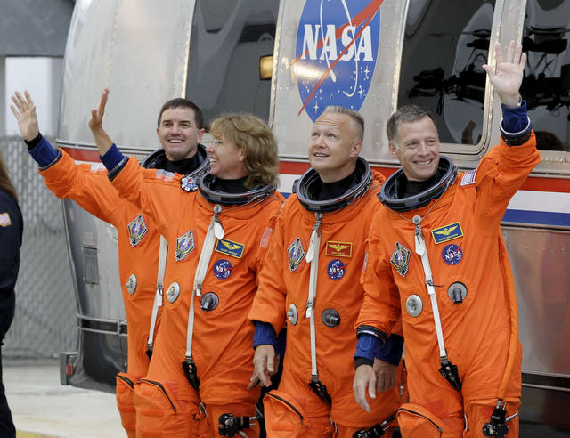 The space shuttle Atlantis astronauts left to right, mission specialists Rex Walheim, Sandy Magnus, pilot Doug Hurley and commander Chris Ferguson, leave the operations and check-out building on the way to the pad at the Kennedy Space Center Friday, July 8, 2011, in Cape Canaveral, Fla. Atlantis is the 135th and final space shuttle launch for NASA. (AP Photo/Terry Renna)