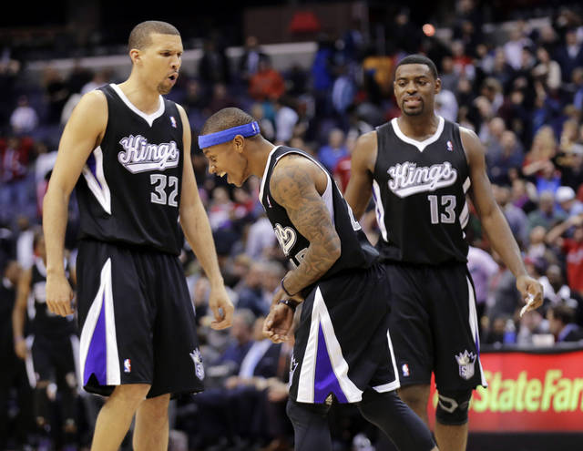 Sacramento Kings guards Francisco Garcia (32), of the Dominican Republic, Isaiah Thomas, center, and Tyreke Evans (13) celebrate Thomas' winning shot against the Washington Wizards during the second half of their NBA basketball game, Monday, Jan. 28, 2013, in Washington. The Kings won 96-94. (AP Photo/Alex Brandon)