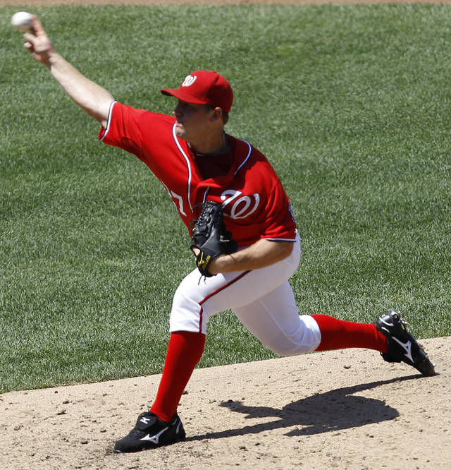 Washington Nationals pitcher Jordan Zimmermann delivers the ball to the New York Mets during the fourth inning of a baseball game in Washington, Sunday, July 31, 2011. (AP Photo/Luis M. Alvarez)
