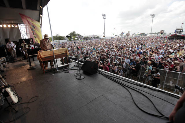 FILE - In this May 1, 2011 file photo, Dr. John (Mac Rebennack) performs at the Louisiana Jazz and Heritage Festival in New Orleans. April marks the start of spring festival season in south Louisiana. As the revelry of Mardi Gras and chill of winter end, spring festivals usher in the flip-flops, floppy hats and folding chairs toted by music lovers from across the globe. French Quarter Festival and Jazz Fest in New Orleans, and Festival International de Louisiana in Lafayette, La., are all held in April. Other Louisiana festivals held in spring and summer include Bayou Country Superfest in May, New Orleans Cajun-Zydeco Festival in June, Essence Music Festival in July and Satchmo Summerfest in August. (AP Photo/Gerald Herbert, File)