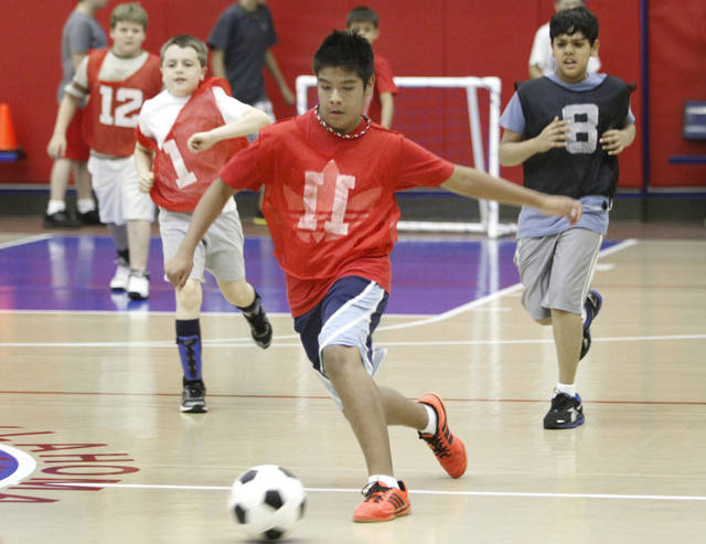 Josh Hernandez, 13, controls the ball during a soccer camp scrimmage at Oklahoma City Community College in Oklahoma City, Monday 16, 2012. Photo By Steve Gooch, The Oklahoman