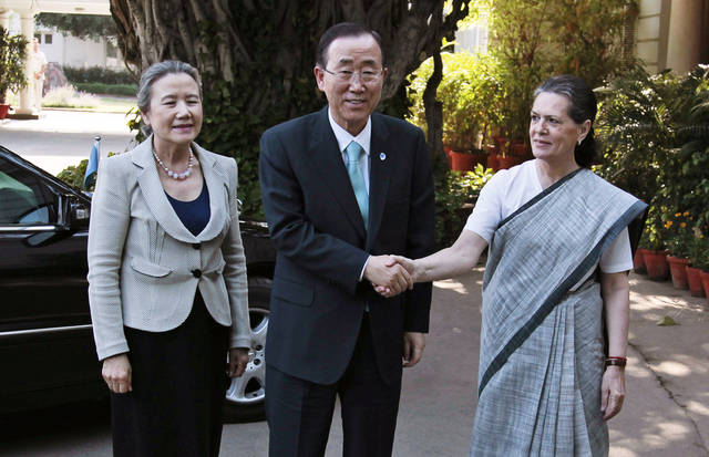 Congress party President Sonia Gandhi, right, shakes hand with U.N. Secretary-General Ban Ki-moon as his wife Yoo Soon-taek, looks on at Gandhi's residence in New Delhi, India, Friday, April 27, 2012. A U.N. statement said that in his meetings with officials, Ban praised India's success in eradicating polio. But he also said India needs to improve its dismal record on maternal health and child mortality. (AP Photo/Saurabh Das)