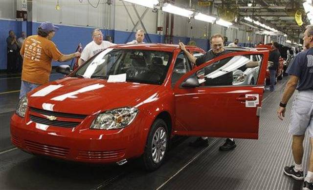 FILE - In this Aug. 21, 2008 file photo, auto workers at the  Lordstown Assembly Plant work on the Chevy Cobalts  in Lordstown, Ohio. The Lordstown plant, which makes the Chevrolet Cobalt and Pontiac G5 small cars, is now running at one shift for 10 hours per day from Monday through Thursday, but the company will add the next two Fridays to the schedule, one union official said Tuesday, Aug. 18, 2009.(AP Photo/Ron Schwane)