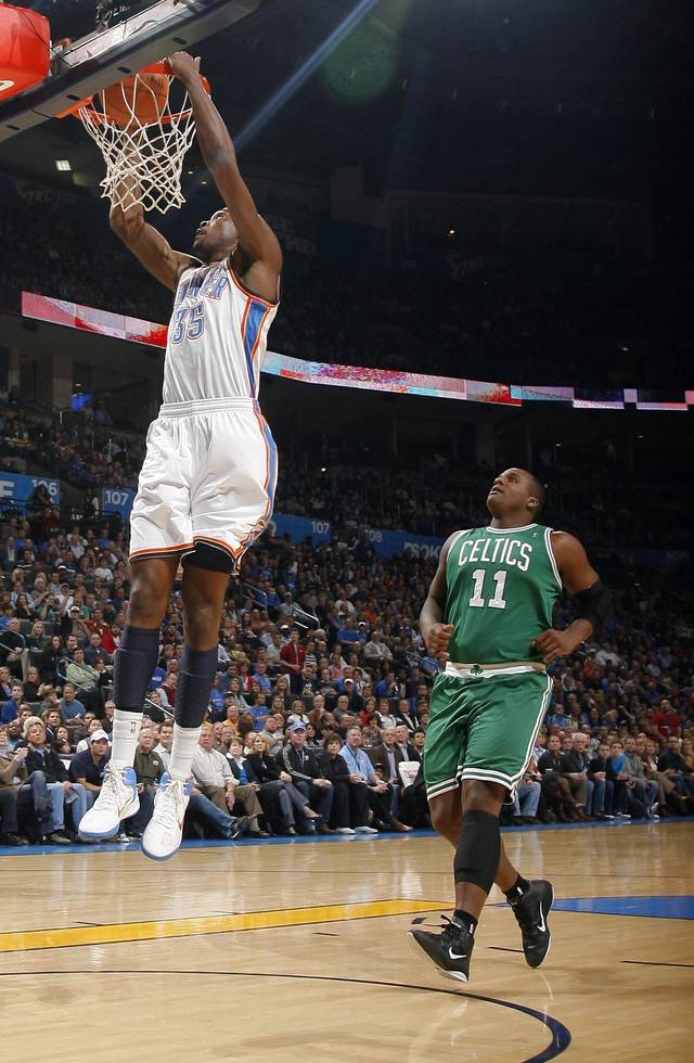 Oklahoma City's Kevin Durant (35) dunks in front of Boston's Glen Davis during the NBA game between the Oklahoma City Thunder and the Boston Celtics, Sunday, Nov. 7, 2010, at the Oklahoma City Arena. Photo by Sarah Phipps, The Oklahoman