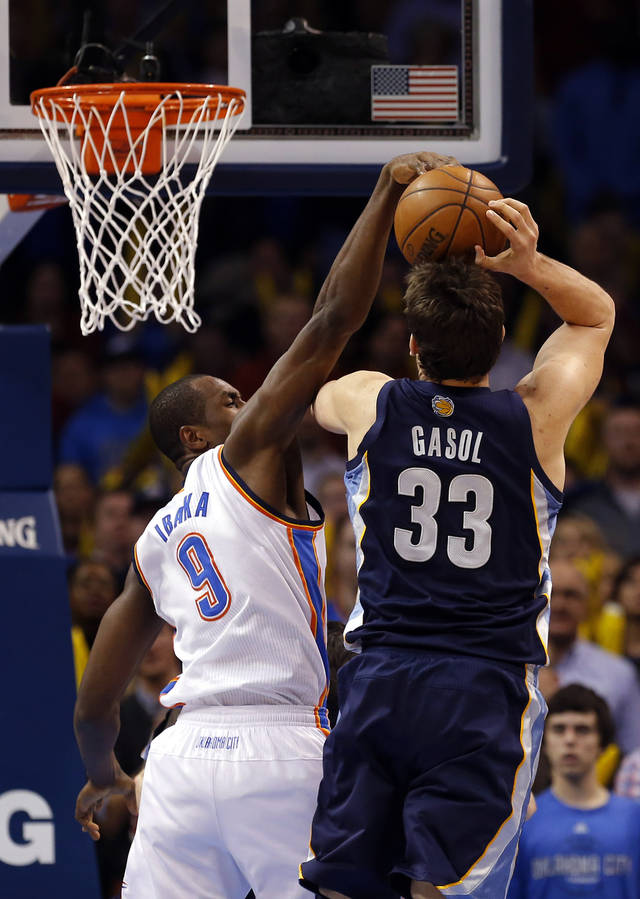 Oklahoma City's Serge Ibaka (9) blocks the shot of Memphis' Marc Gasol (33) during the NBA basketball game between the Oklahoma City Thunder and the Memphis Grizzlies at the Chesapeake Energy Arena in Oklahoma City,  Thursday, Jan. 31, 2013.Photo by Sarah Phipps, The Oklahoman