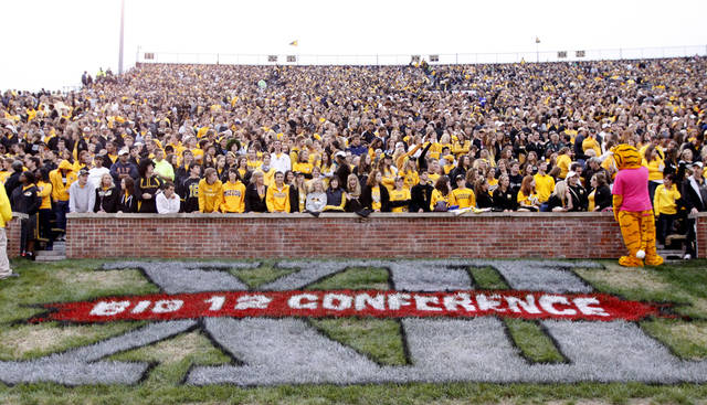 FILE - In this Sept. 17, 2011 file photo, a Big 12 Conference logo is shown during the first quarter of an NCAA college football game between the Missouri and the Western Illinois in Columbia, Mo. Missouri has taken another step toward leaving the Big 12 Conference and there is interest in the SEC in taking the Tigers. The governing curators at Missouri unanimously gave Chancellor Brady Deaton the authority Friday, Oct. 21, 2011, to move the school out of the Big 12 if he decides that is in the school's best interest. He gave no timeline for a decision but indicated that a move, if it happens, would not take much longer. (AP Photo/Jeff Roberson, File) ORG XMIT: NY157