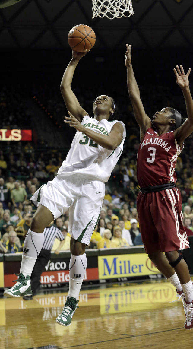 Baylor's Brooklyn Pope (32) shoots against Oklahoma's Aaryn Ellenberg (3) during the first half of an NCAA college basketball game Saturday, Jan. 26, 2013, in Waco Texas. (AP Photo/LM Otero) ORG XMIT: TXMO103