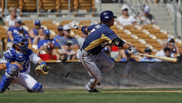Milwaukee Brewers' Norichika Aoki, right, heads toward first base after hitting a ground ball to third in the fifth inning against the Los Angeles Dodgers in a spring training baseball game on Friday, March 30, 2012, in Glendale, Ariz. Aoki was out at first. (AP Photo/Lenny Ignelzi)