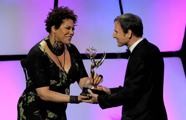 "Kim Coles, left, presents the talk show - entertainment award to Michael Gelman for ""Live with Regis and Kelly"" onstage at the 39th Annual Daytime Emmy Awards at the Beverly Hilton Hotel on Saturday, June 23, 2012 in Beverly Hills, Calif. (Photo by Chris Pizzello/Invision/AP)"