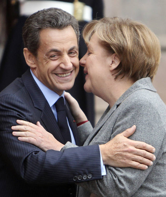 "FILE - In this Nov. 24, 2011 file photo, German Chancellor Angela Merkel and French President Nicolas Sarkozy say goodbye after their meeting in Strasbourg, France. Sarkozy and Merkel are scheduled to meet in Paris on Monday, Dec. 5, 2011, to unveil a proposal for closer political and economic ties between the 17 countries that use the euro. While the leaders differ on some of the details, their cooperation has been so tight they have come to be known by a single name: ""Merkozy."" (AP Photo/Michael Probst, File) ORG XMIT: NY116"