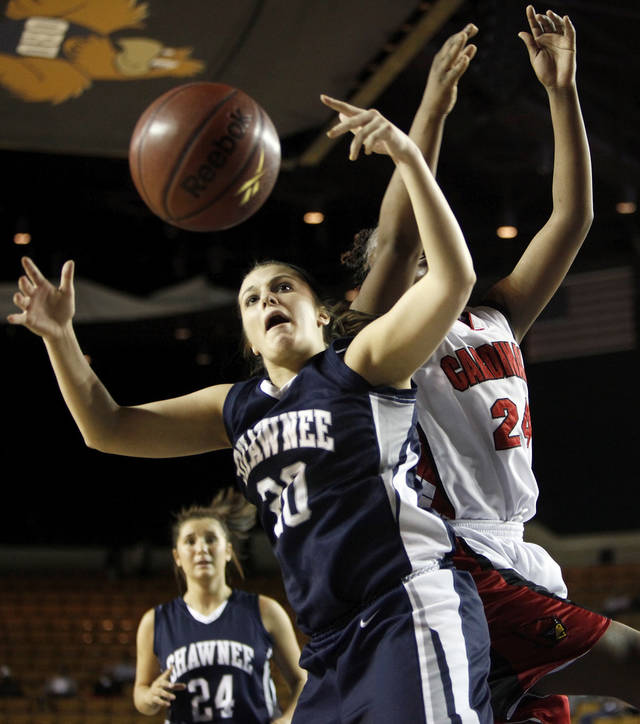 Shawnee's McKenzie Cooper (20) and East Central's Felecia Achilefu (24) chase a rebound during the Class 5A girls high school basketball state tournament championship game between Shawnee and East Central at the Mabee Center in Tulsa, Okla., Saturday, March 10, 2012. Photo by Nate Billings, The Oklahoman