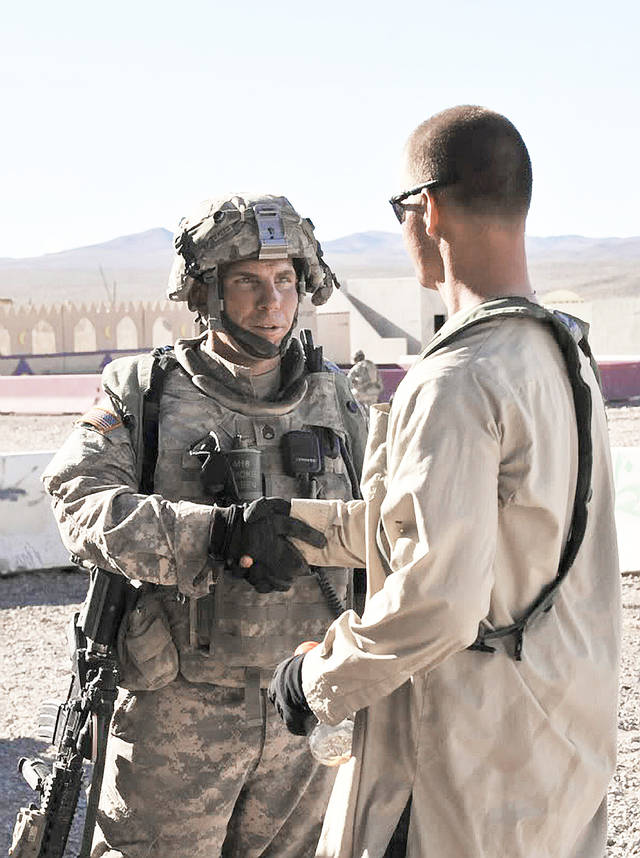 Staff Sgt. Robert Bales, left, is suspected in the horrific nighttime slaughter of 16 Afghan villagers. He and his attorney, John Henry Browne of Seattle, are scheduled to meet for the first time Monday. AP File photo