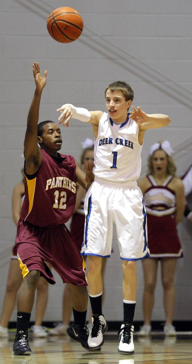 Deer Creek's Austin Valentine passes the ball as Putnam City North's Jordan Jackson defends during a game at the Bruce Gray Invitational at Deer Creek high school, Friday, Jan. 20, 2012, in Oklahoma City, Okla. Photo by Sarah Phipps, The Oklahoman