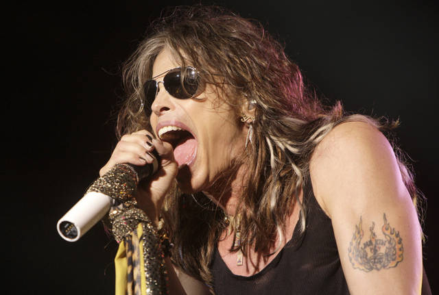 FILE- In this June 10, 2009 file photo, vocalist  Steven Tyler, of the rock band Aerosmith, performs at the Verizon Wireless Amphitheater in Maryland Heights, Mo. Tyler plans to attend a legislative hearing in Hawaii on Friday, Feb. 8, 2013, on a bill that bears his name and would limit people's freedom to take photos and video of celebrities. (AP Photo/Jeff Roberson, File)