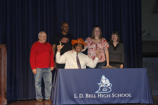 Oklahoma State football signee Jesse Robinson celebrates after signing his national letters of intent at L.D. Bell High School in Hurst, Texas. PHOTO BY GINA MIZELL, The Oklahoman