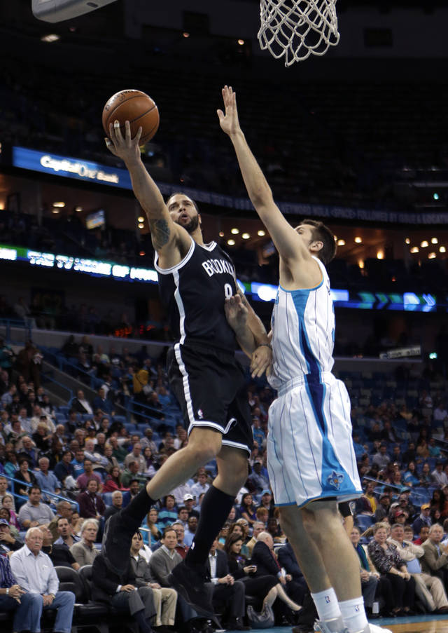 Brooklyn Nets guard Deron Williams (8) drives to the basket against New Orleans Hornets forward Ryan Anderson in the first half of an NBA basketball game in New Orleans, Tuesday, Feb. 26, 2013. (AP Photo/Gerald Herbert)