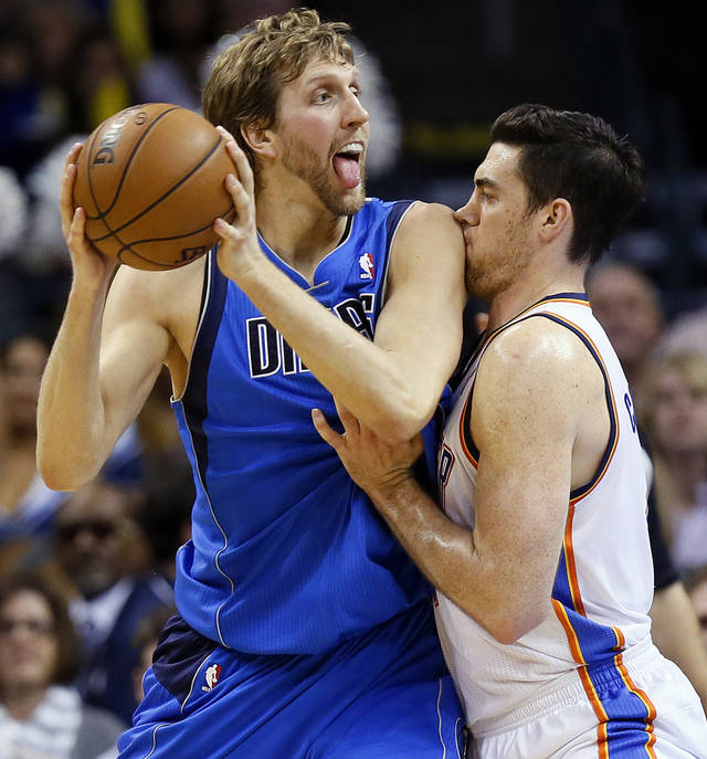 Oklahoma City&#039;s Nick Collison (4) defends Dallas&#039; Dirk Nowitzki (41) during an NBA basketball game between the Oklahoma City Thunder and the Dallas Mavericks at Chesapeake Energy Arena in Oklahoma City, Monday, Feb. 4, 2013. Photo by Nate Billings, The Oklahoman