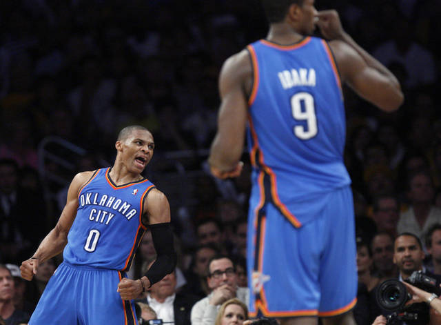 Oklahoma City's Russell Westbrook (0) and Serge Ibaka (9) celebrate during Game 4 in the second round of the NBA basketball playoffs between the L.A. Lakers and the Oklahoma City Thunder at the Staples Center in Los Angeles, Saturday, May 19, 2012. Photo by Nate Billings, The Oklahoman