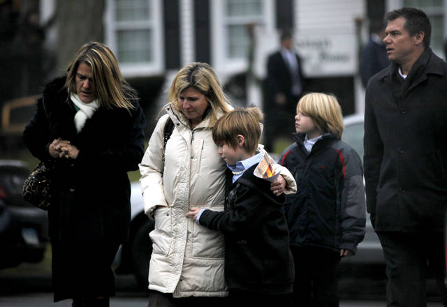 Mourners leave the funeral service of Sandy Hook Elementary School shooting victim, Jack Pinto, 6, Monday, Dec. 17, 2012, in Newtown, Conn. Pinto was killed when a gunman walked into Sandy Hook Elementary School in Newtown Friday and opened fire, killing 26 people, including 20 children.(AP Photo/David Goldman) ORG XMIT: CTDG122