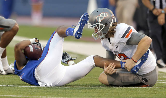 Oklahoma State's Quinn Sharp (13) tackles Kansas' Tre' Parmalee (11) during the college football game between Oklahoma State University (OSU) and the University of Kansas (KU) at Memorial Stadium in Lawrence, Kan., Saturday, Oct. 13, 2012. Photo by Sarah Phipps, The Oklahoman