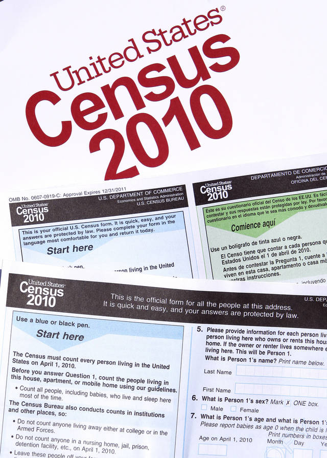 Copies of the 2010 census forms are seen during a March 15 news conference  in Phoenix. Officials say that everyone should have received a census form in the mail by now. AP PHOTO