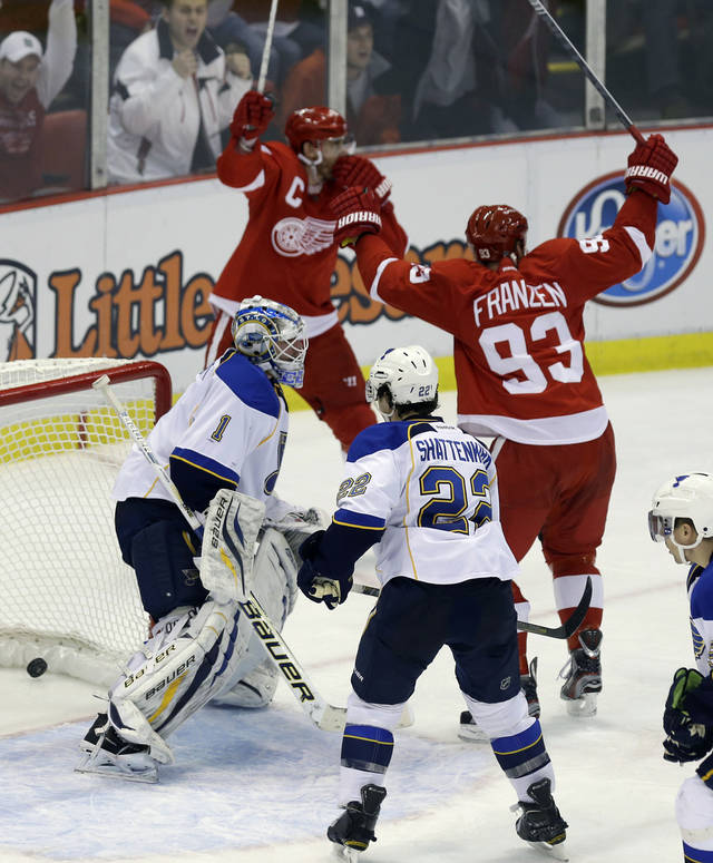Detroit Red Wings' Johan Franzen (93) and Henrik Zetterberg, both of Sweden, celebrate the game-winning goal by teammate Pavel Datsyuk, not in frame, past St. Louis Blues goalie Brian Elliott (1) during the third period of an NHL hockey game in Detroit, Friday, Feb. 1, 2013. (AP Photo/Carlos Osorio)