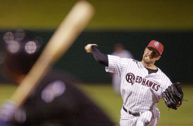 R.A. Dickey of the Oklahoma RedHawks pitches in the minor league baseball game against the Colorado Springs Sky Sox at the SBC Bricktown Ballpark in Oklahoma City, Friday, April 4, 2003. Staff photo by Nate Billings.