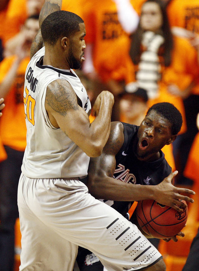 Oklahoma State's Michael Cobbins (20) defends Gonzaga's Gary Bell, Jr. (5) during a men's college basketball game between Oklahoma State University (OSU) and Gonzaga at Gallagher-Iba Arena in Stillwater, Okla., Monday, Dec. 31, 2012. Photo by Nate Billings, The Oklahoman