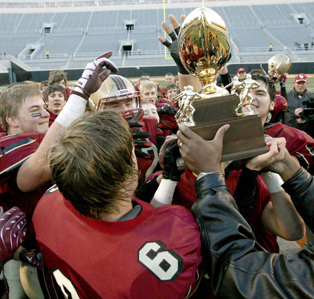 Lincoln Christian celebrates after winning the Class 2A high school football state championship game between Kingfisher and Lincoln Christian at Boone Pickens Stadium in Stillwater, Okla., Saturday, December 12, 2009.  Photo by Bryan Terry, The Oklahoman