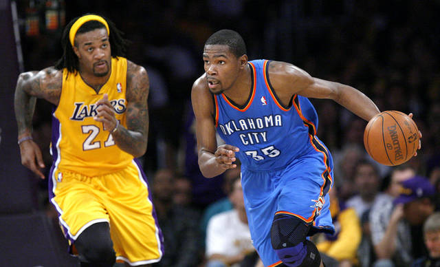 Oklahoma City's Kevin Durant (35) drives up court as Los Angeles' Jordan Hill (27) defends during Game 4 in the second round of the NBA basketball playoffs between the L.A. Lakers and the Oklahoma City Thunder at the Staples Center in Los Angeles, Saturday, May 19, 2012. Photo by Nate Billings, The Oklahoman