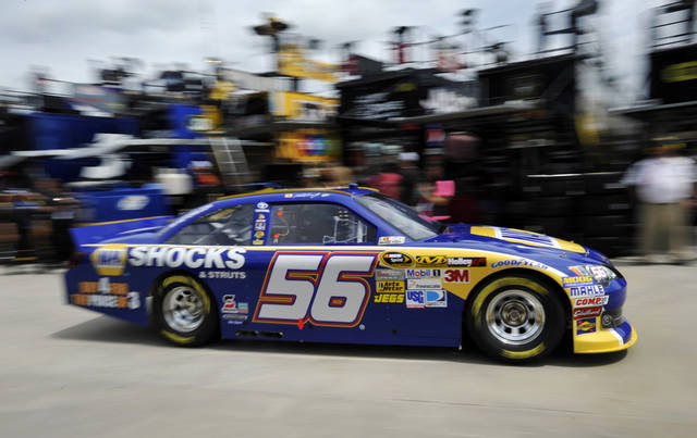 Martin Truex Jr. drives his car through the garage area during practice for Sunday's NASCAR Sprint Cup Series auto race at Atlanta Motor Speedway, Friday, Aug. 31, 2012, in Hampton, Ga. (AP Photo/Rainier Ehrhardt)