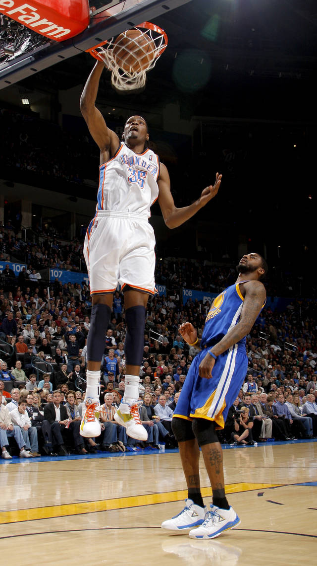 Oklahoma City's Kevin Durant (35) dunks the ball beside Golden State's Dorell Wright (1) during the NBA basketball game between the Oklahoma City Thunder and the Golden State Warriors at the Oklahoma City Arena, Tuesday, March 29, 2011. Photo by Bryan Terry, The Oklahoman