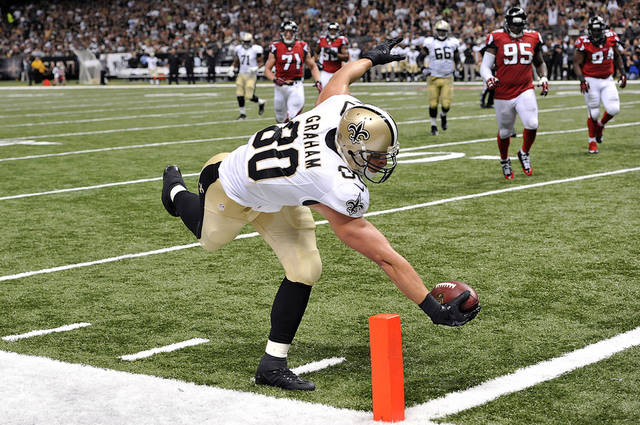 New Orleans Saints tight end Jimmy Graham (80) reaches over the pylon to score a touchdown on a pass play in the second half of an NFL football game against the Atlanta Falcons in New Orleans, Sunday, Sept. 8, 2013. (AP Photo/Bill Feig)