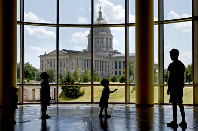 From left, Blaise Volpe, 2, Jacob Volpe, 6, Vince Volpe, 3, and Gabe Volpe, 12, of Harrah visit the Oklahoma History Center on Thursday, July 5, 2012. Photo by Bryan Terry, The Oklahoman